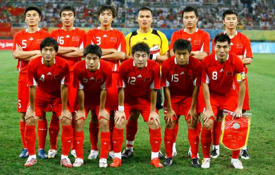 Members of the Chinese team pose before their men's first round Group C soccer match against Belgium at the Beijing 2008 Olympic Games